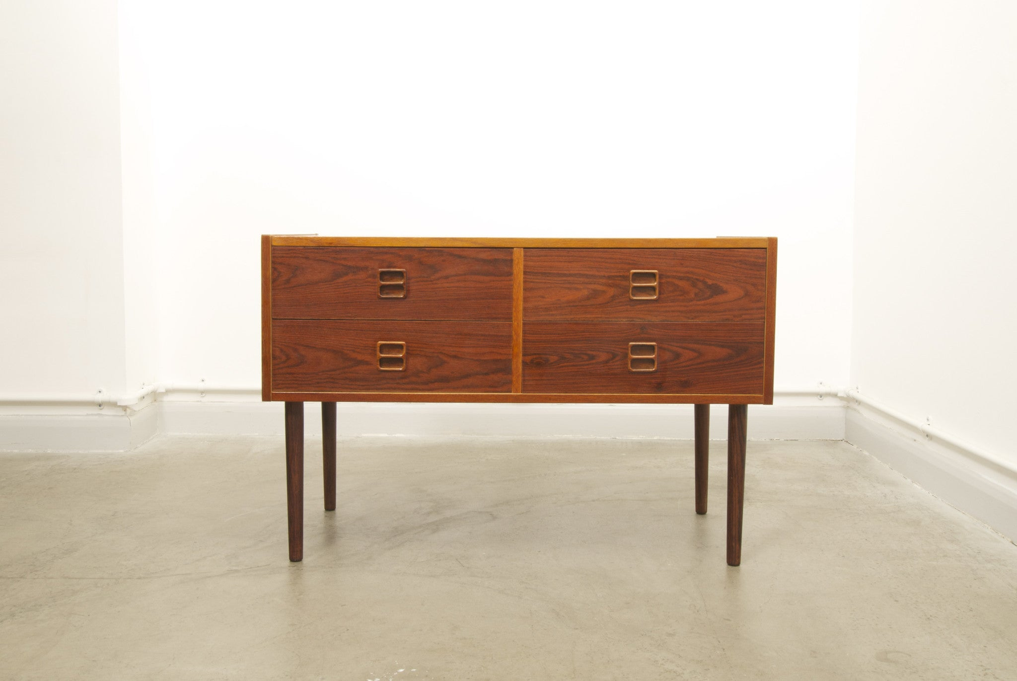 Low chest of drawers in rosewood