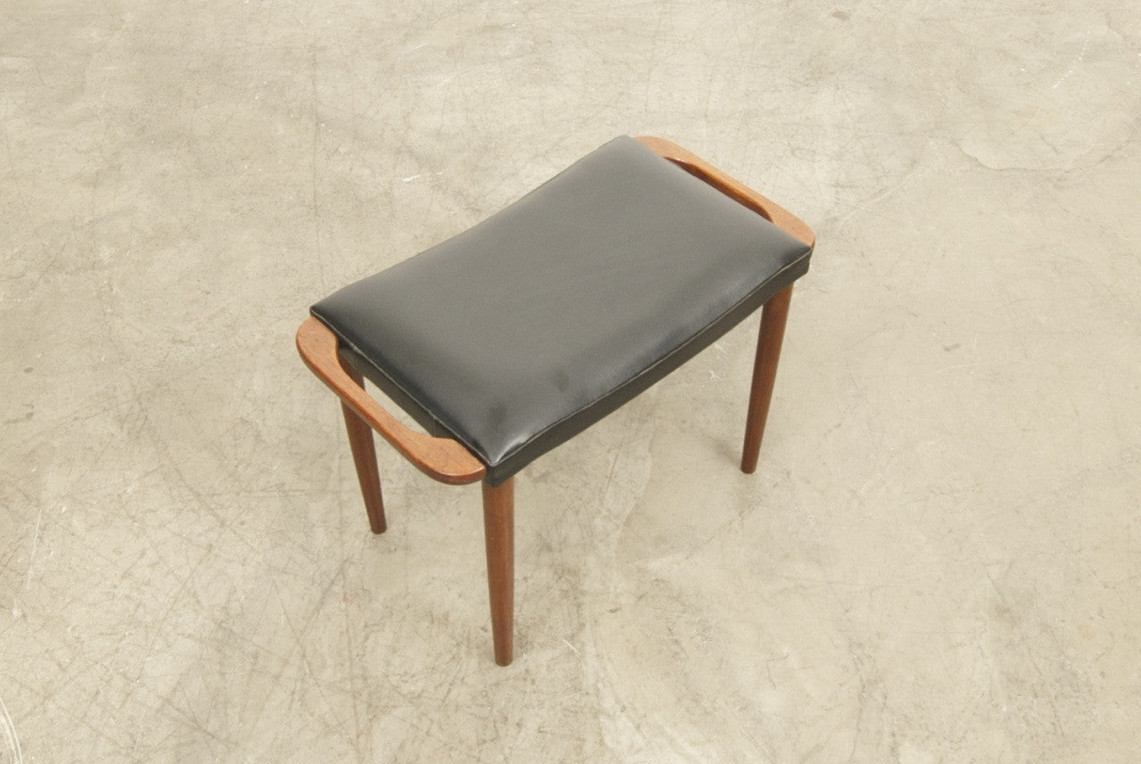 Foot stool in teak with vinyl upholstery