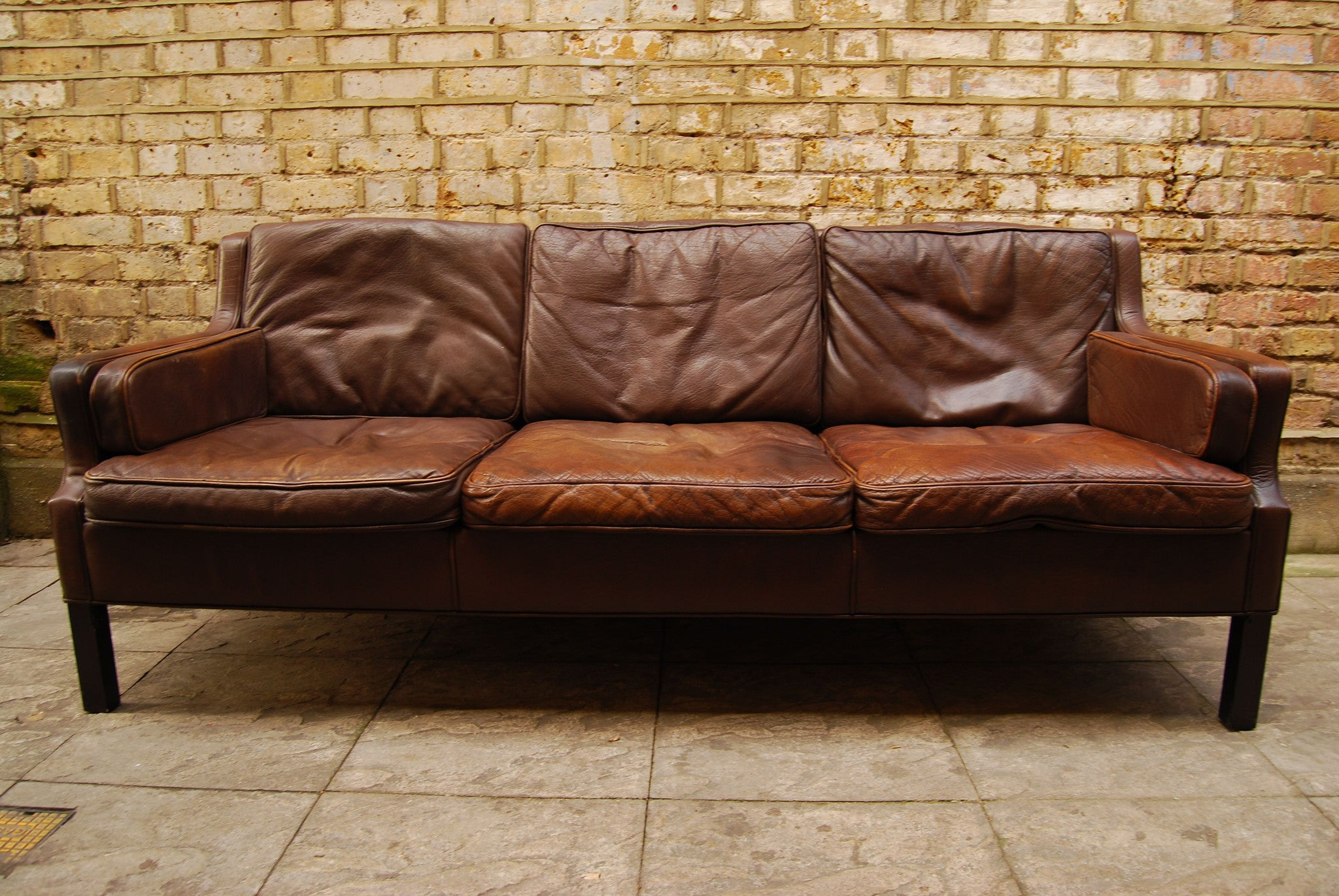 Three seat leather sofa by Thams