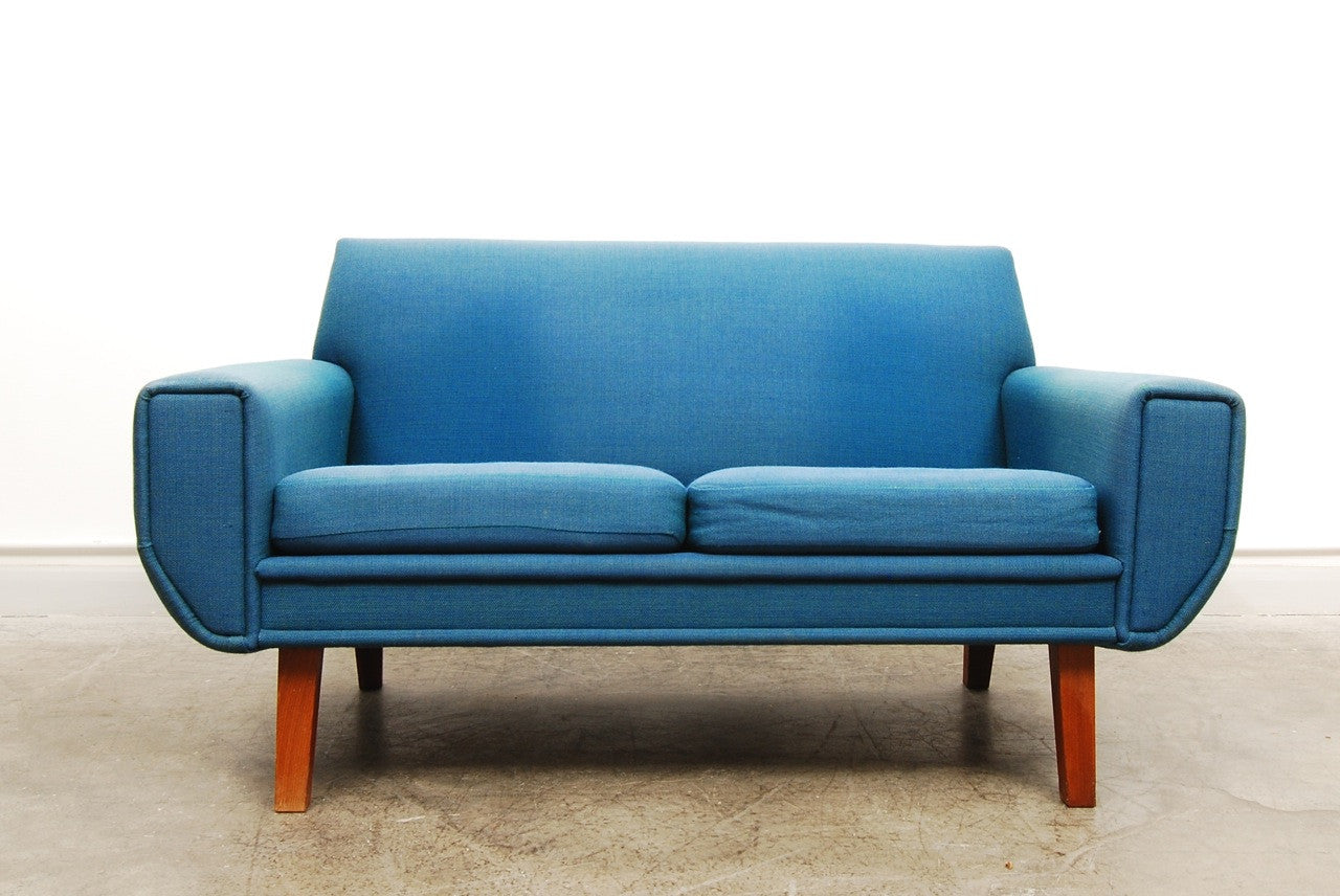 Blue two seat sofa