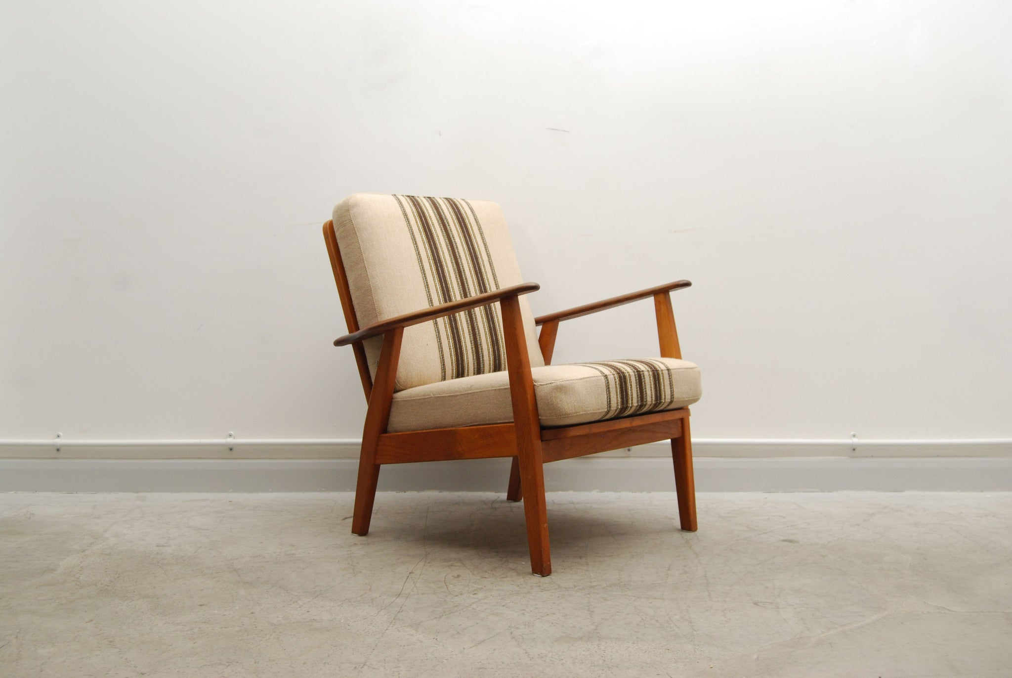 Teak lounge chair with striped cushions