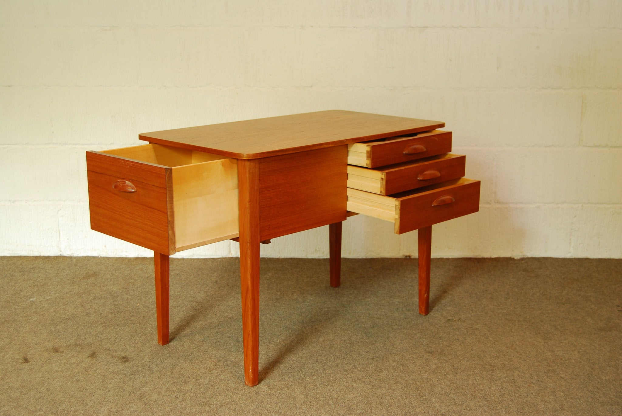 Birch-lined teak sewing table