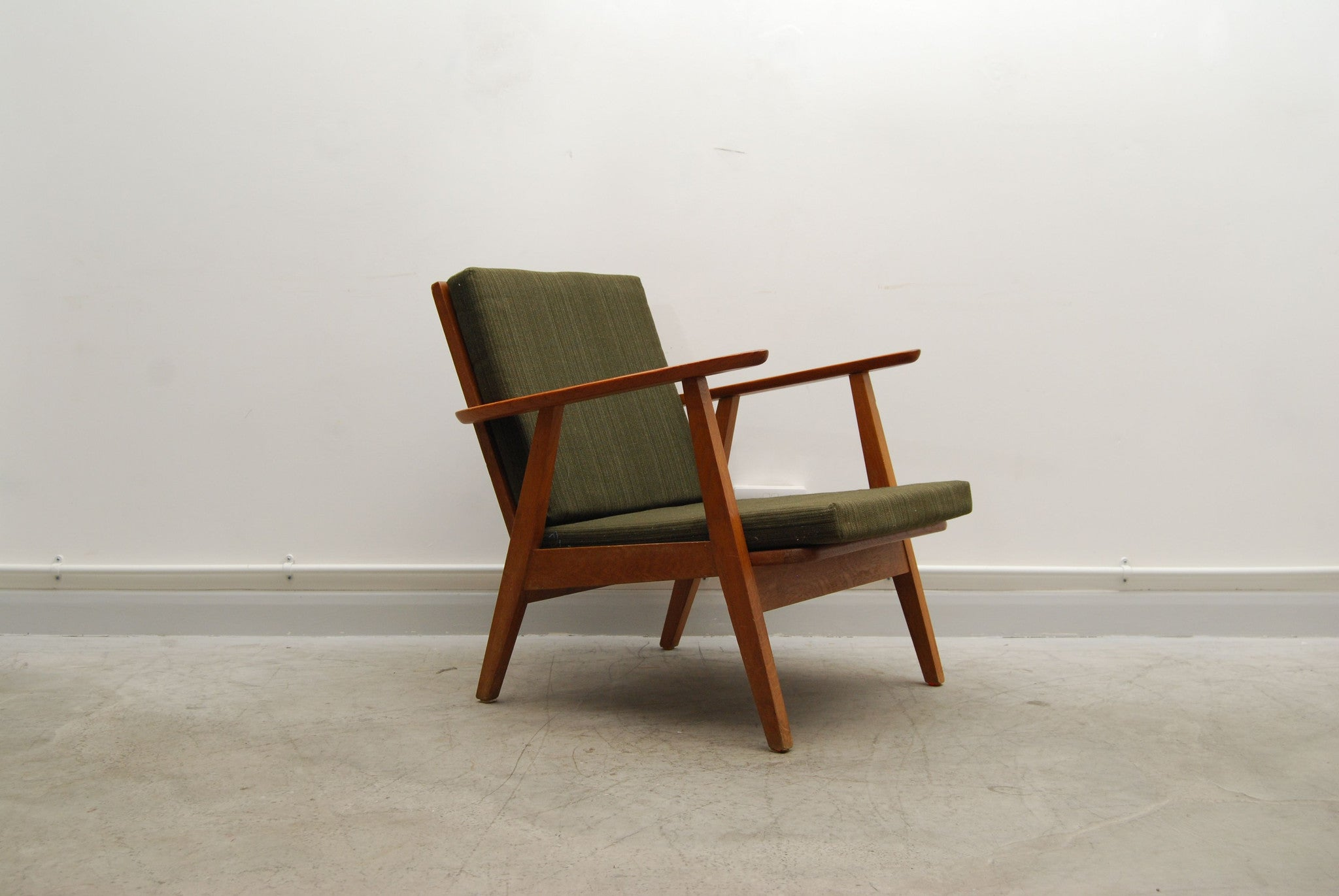 Teak lounge chair with forest green cushions
