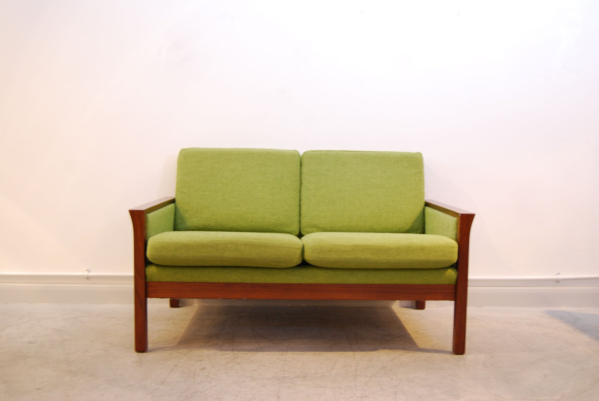 Grass green and teak two seat sofa