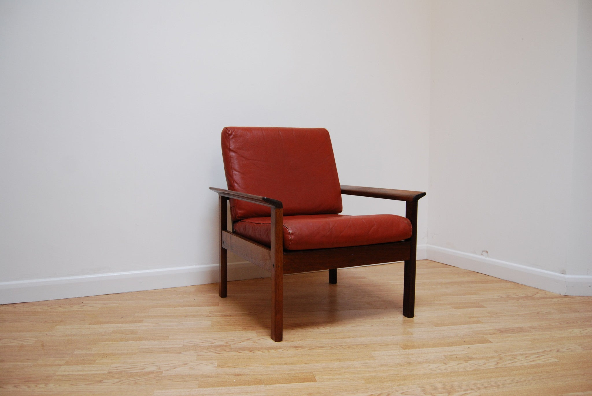 Lounge chair in rosewood and leather