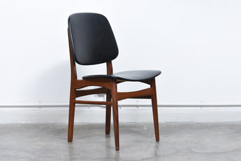 Set of four dining chairs in teak and skai
