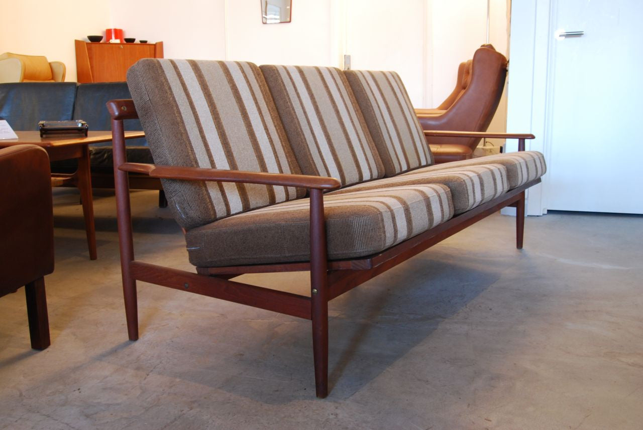 Teak-framed three seater