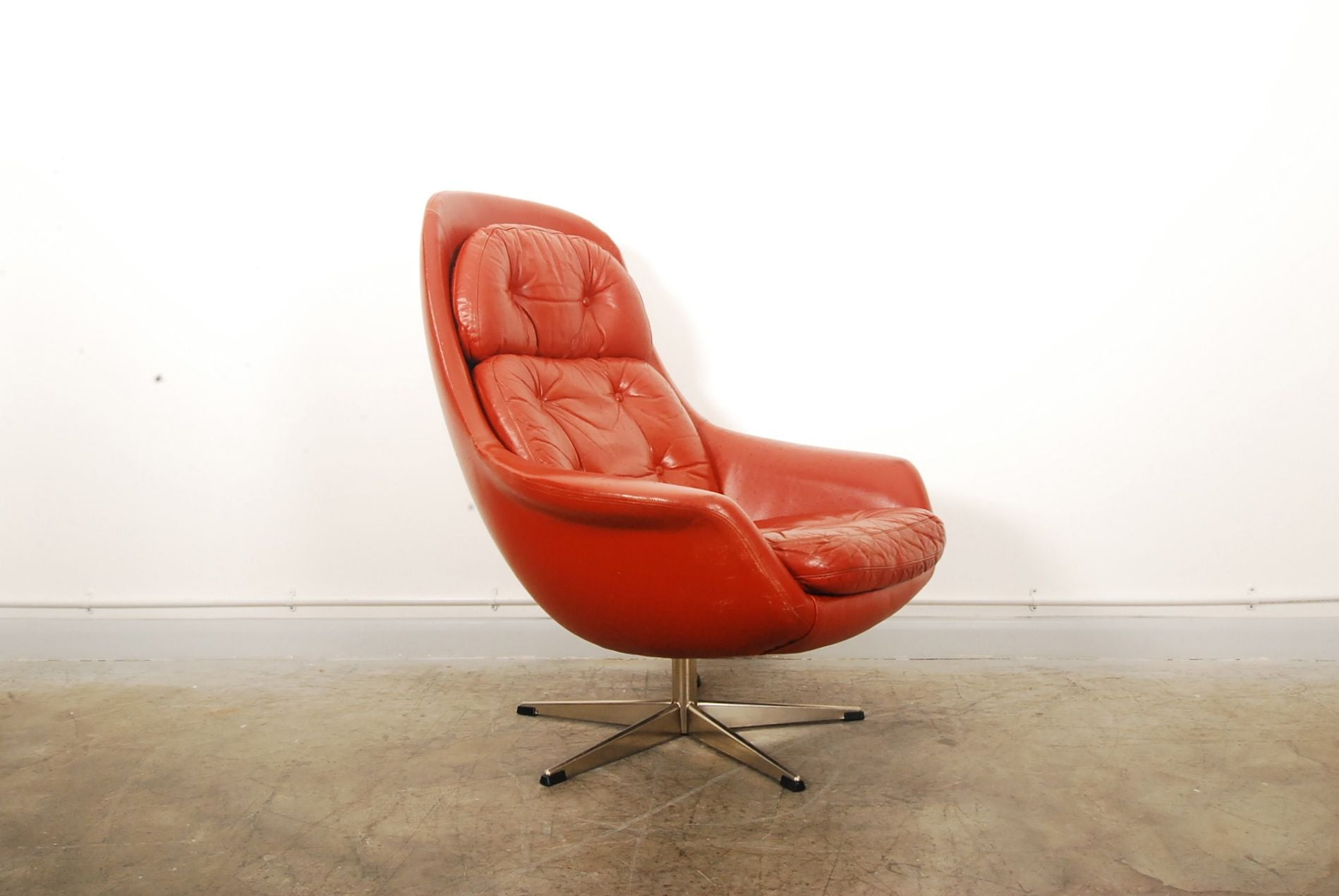 Red leather bucket chair by H.W. Klein