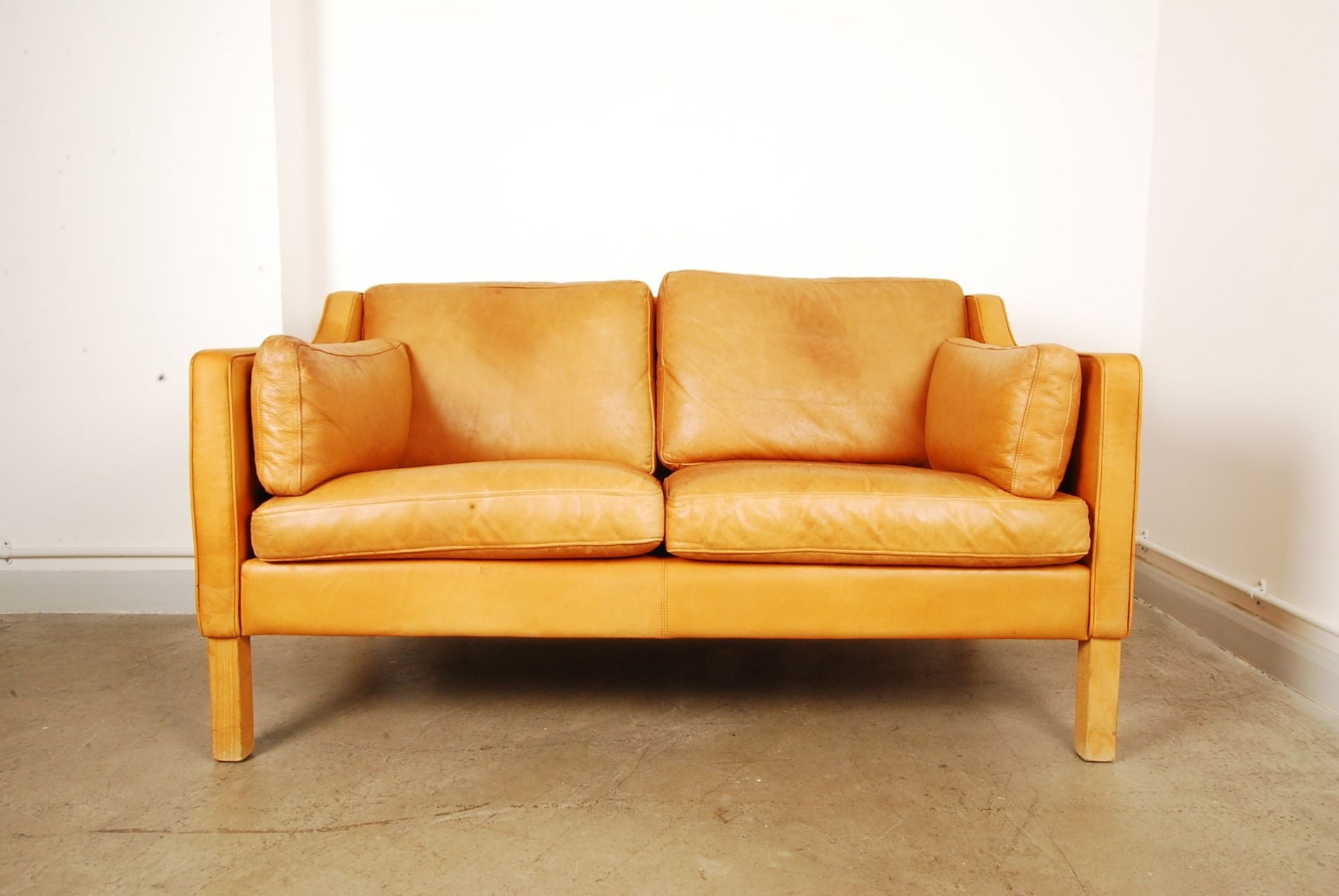 Tan two seat leather sofa