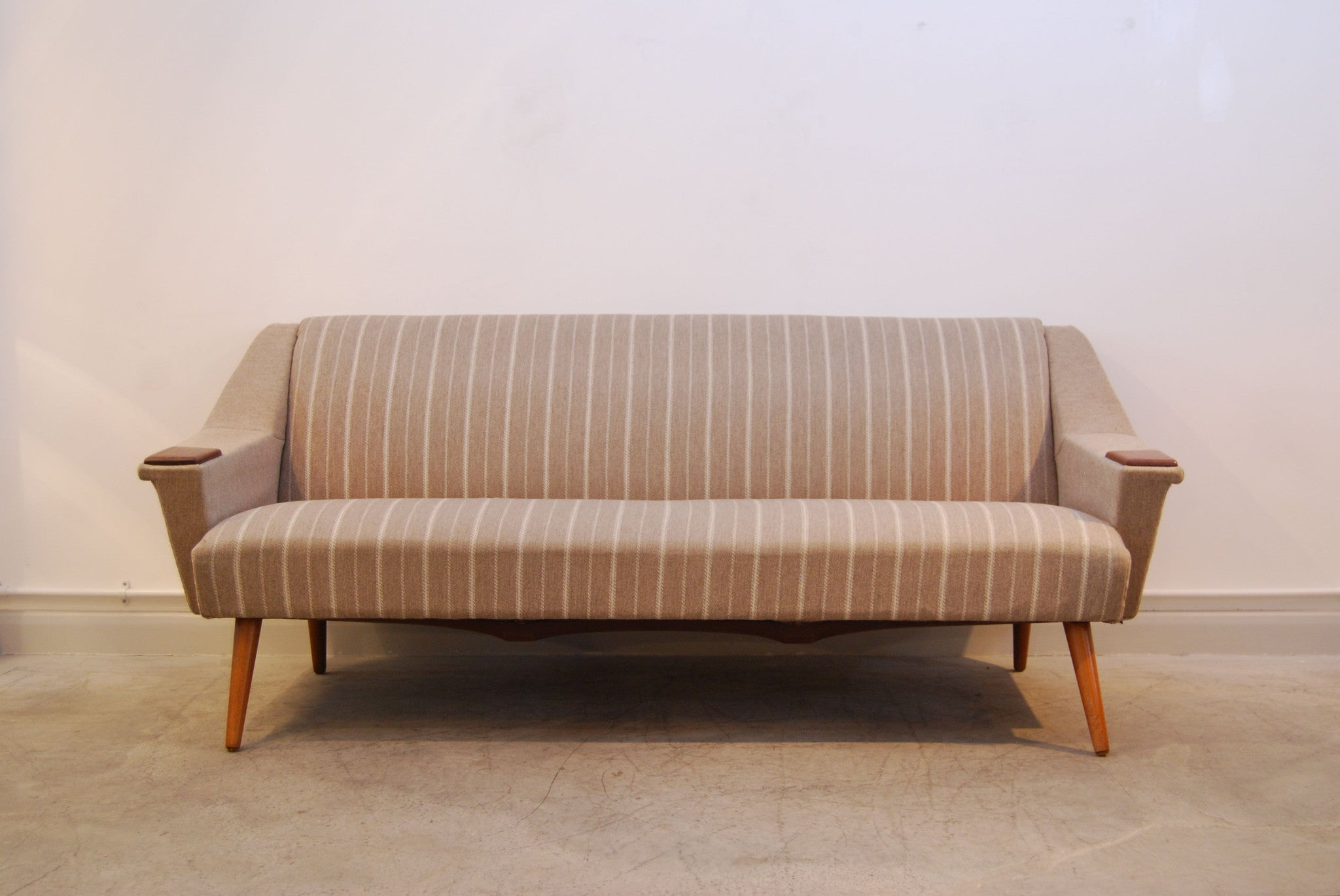 Three seat sofa with teak paws and legs