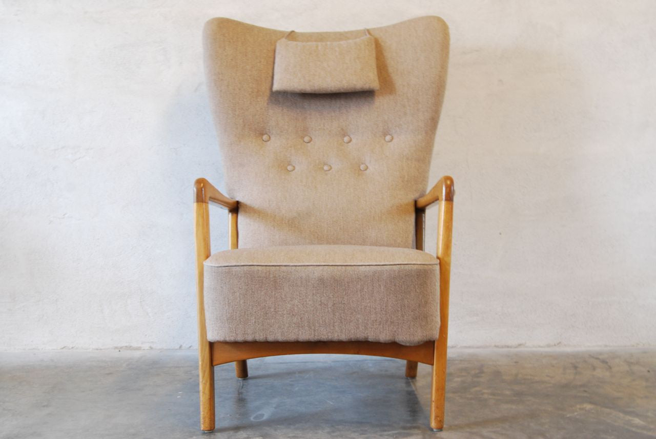 Wingback chair with grey upholstery
