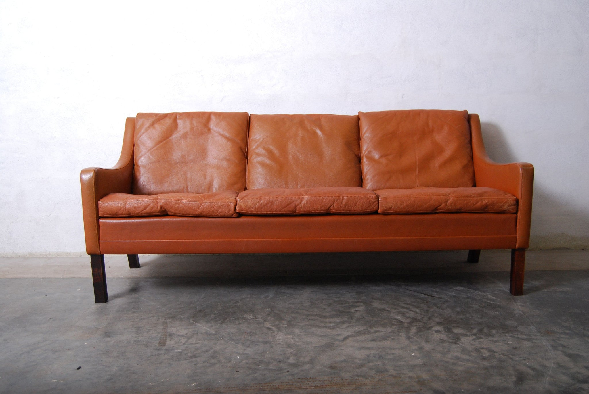 Three seater in cognac leather