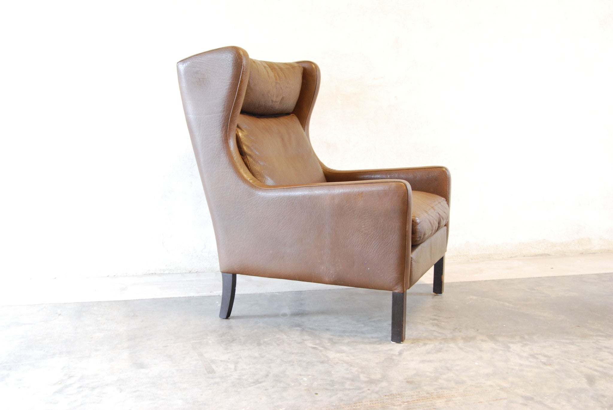 Wingback lounge chair in buffalo leather