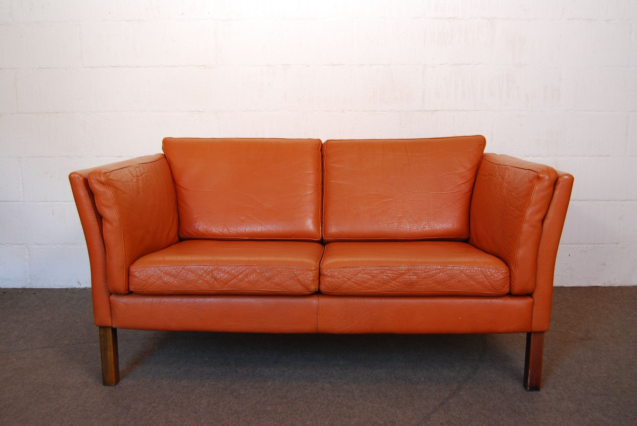 Two seat leather sofa by Mogens Hansen