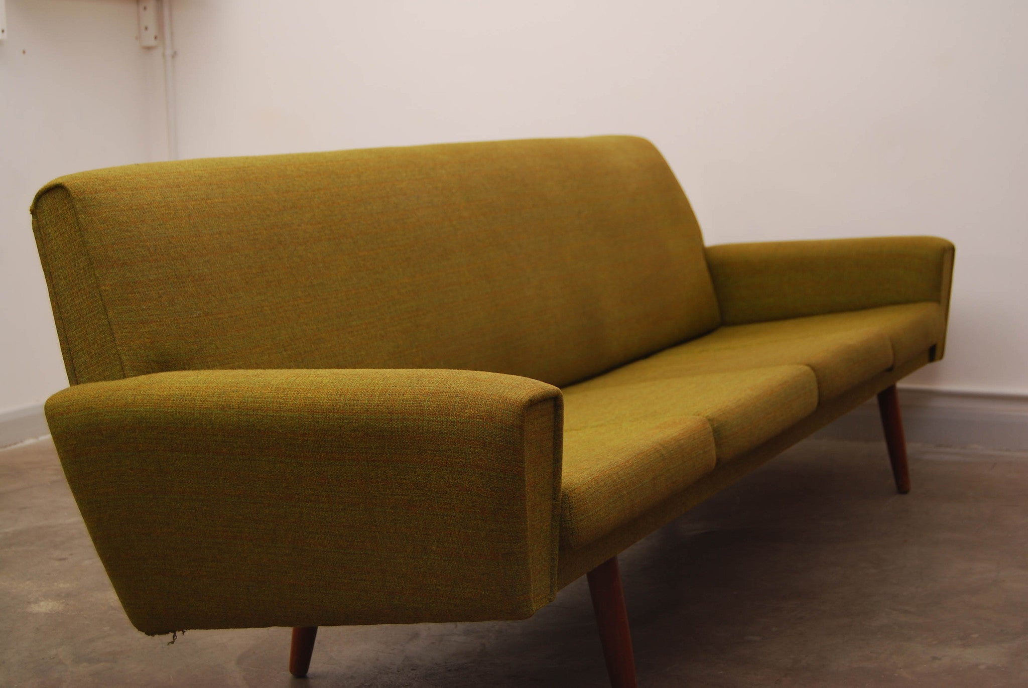 Four seat sofa in olive green wool