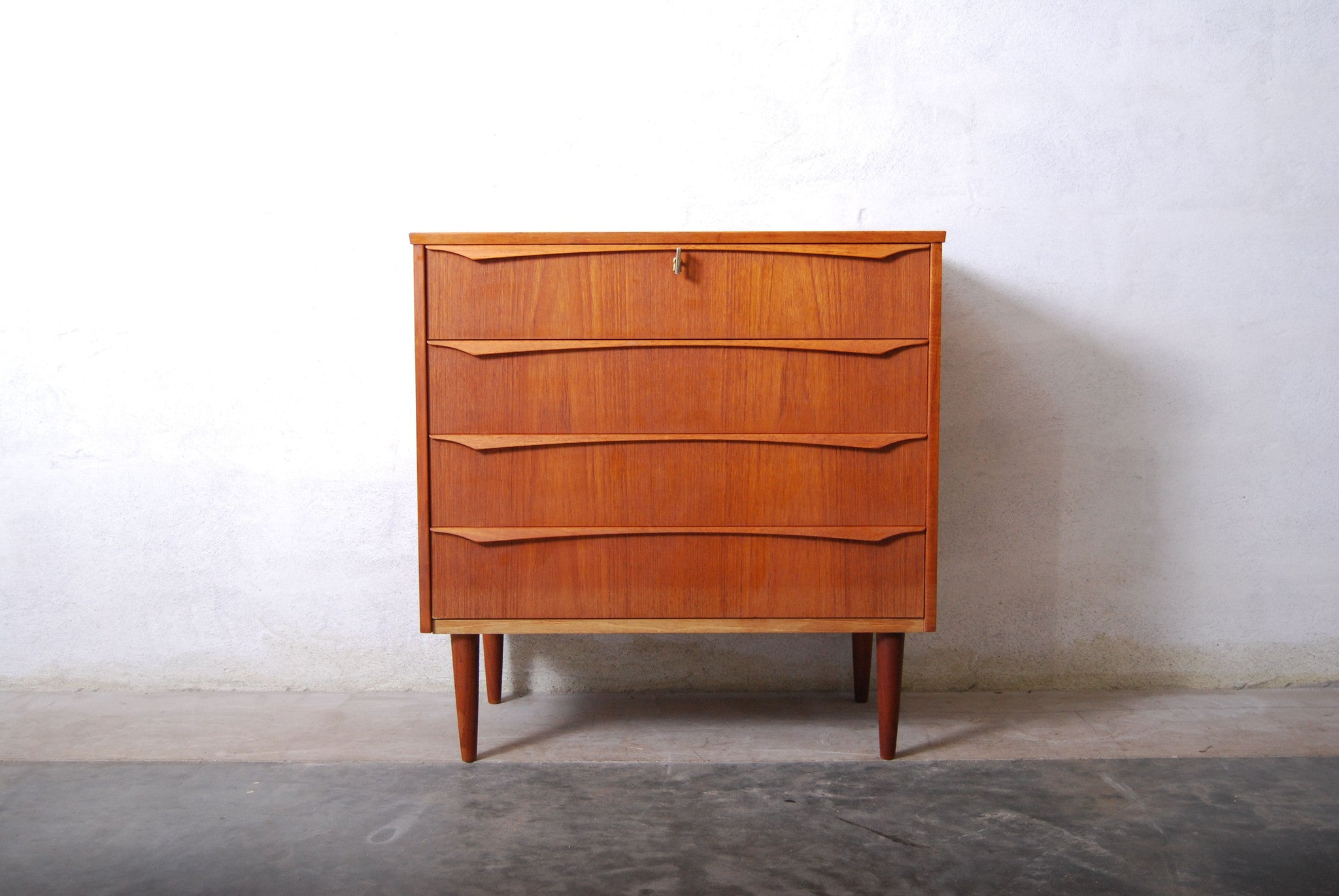 Short chest of four drawers with lipped handles