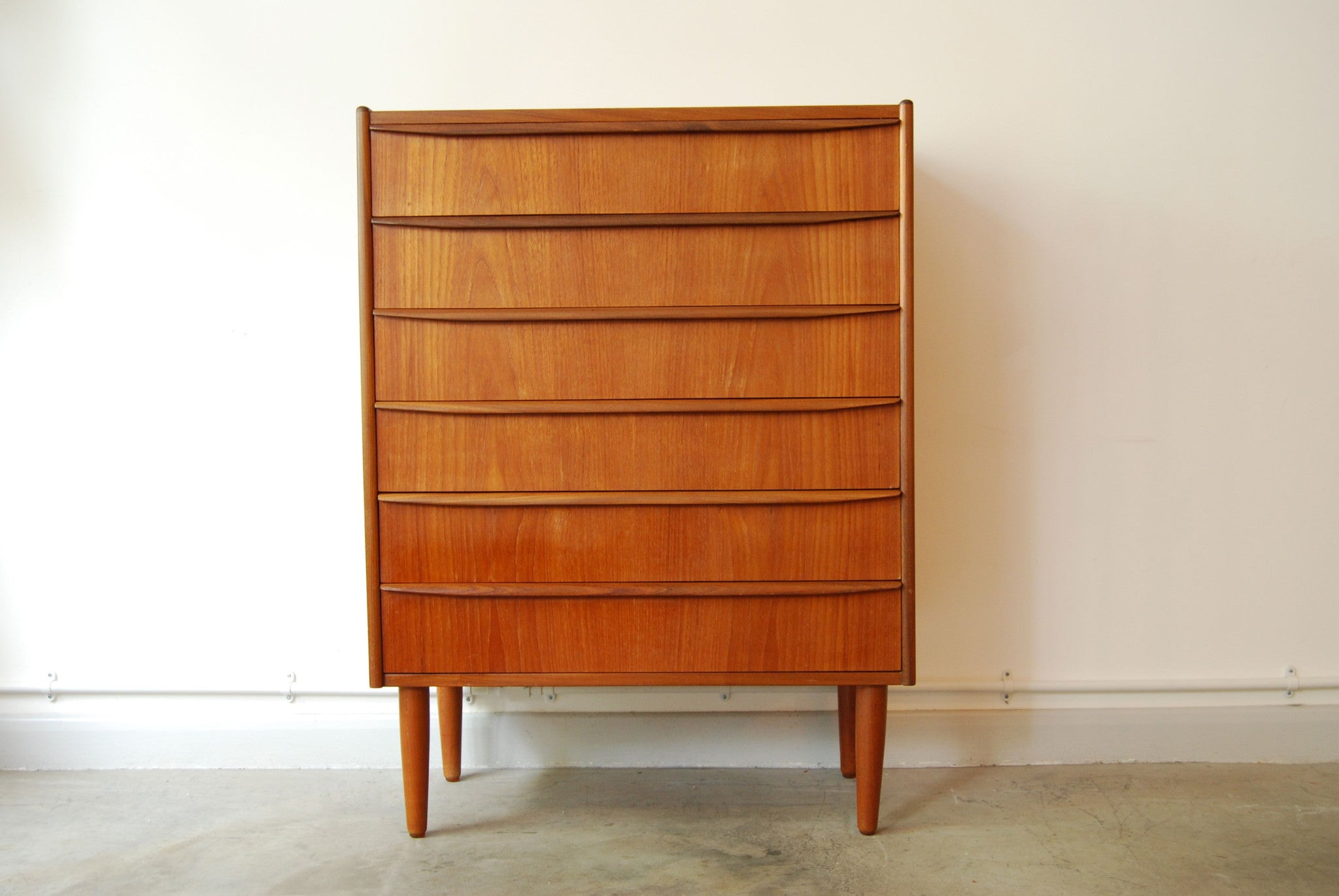 Teak chest of drawers with lipped handles