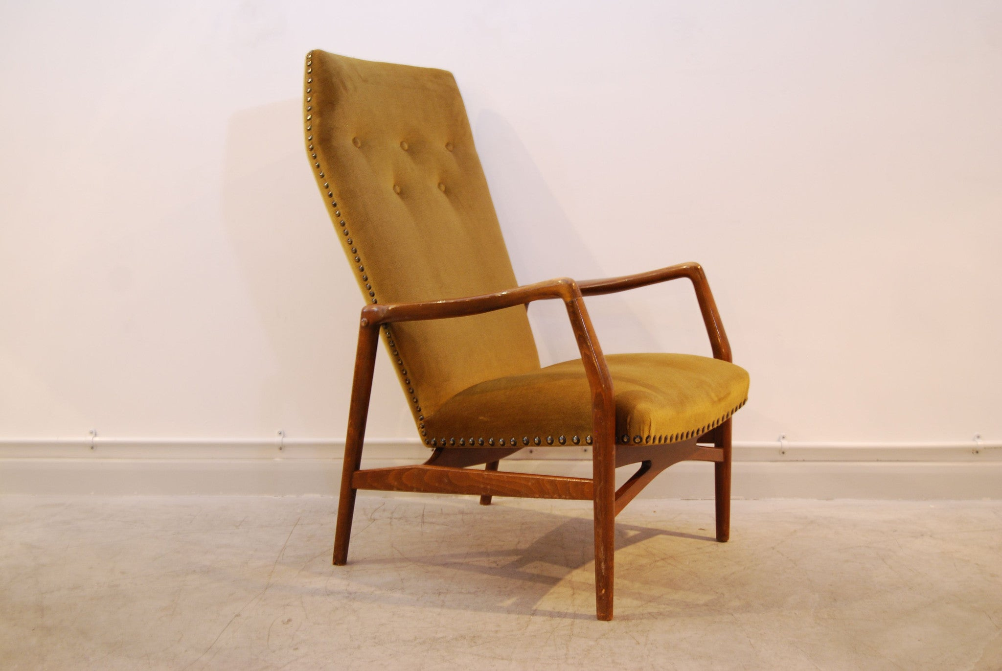 Highback lounge chair by Kurt Olsen
