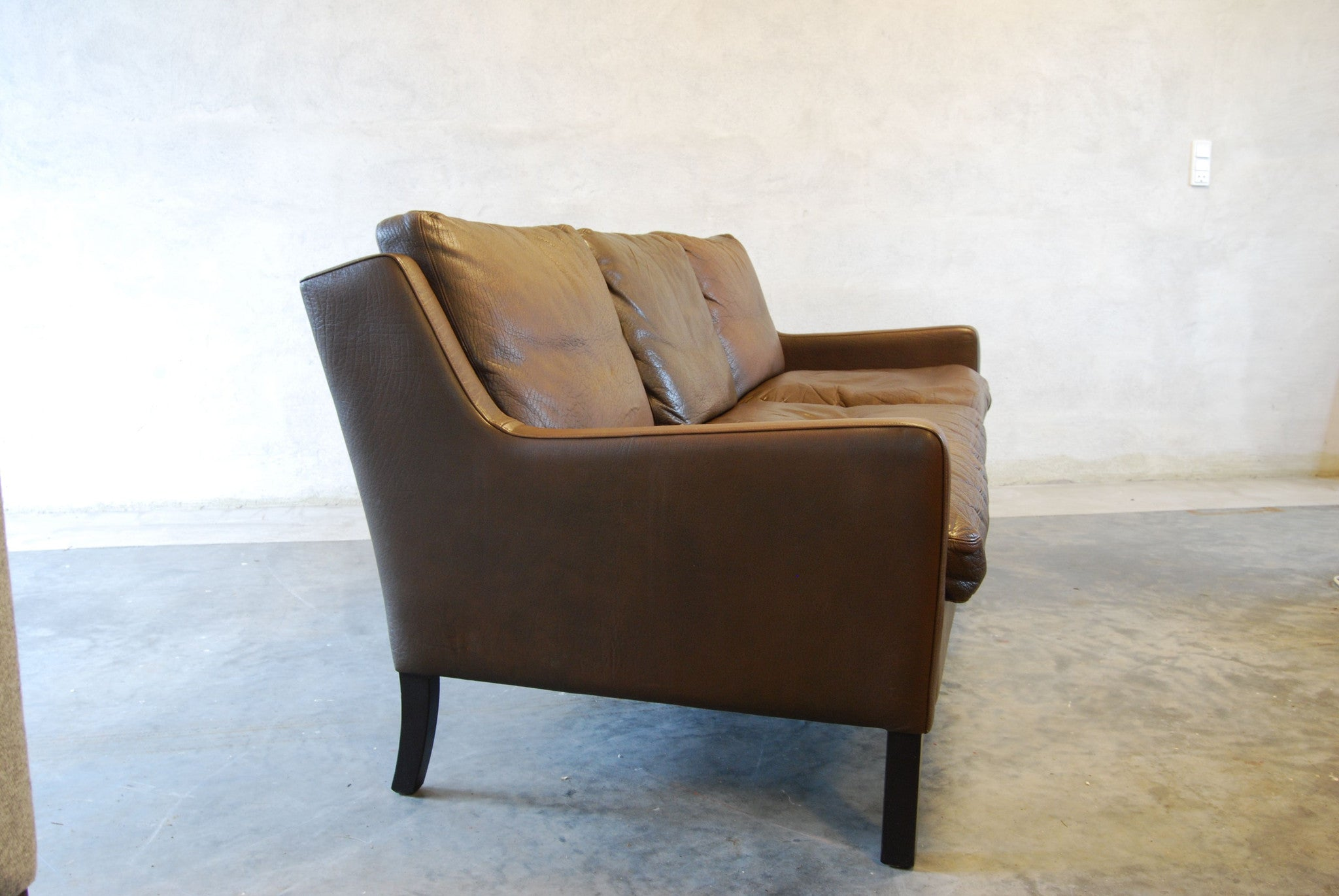 Three seat sofa in buffalo leather