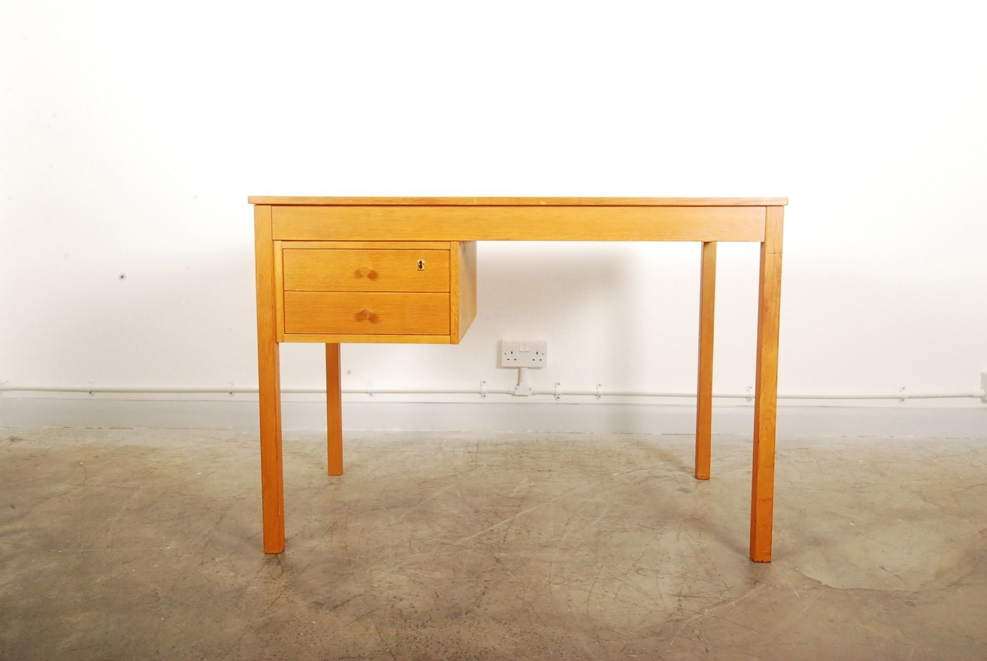 Single pedestal oak desk by SKM