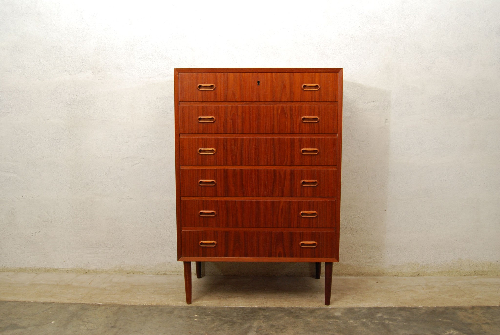 Tall chest of drawers in teak