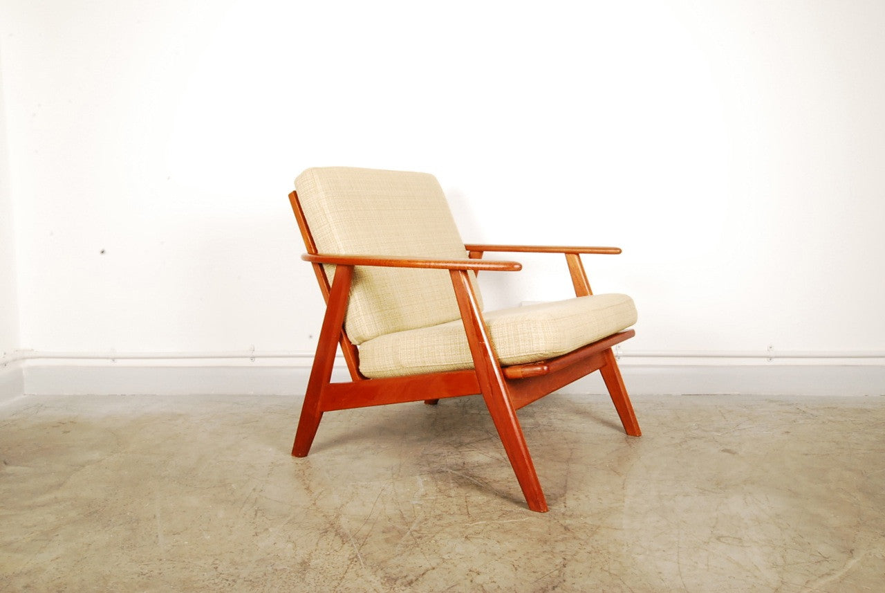 Teak lounge chair with creme cushions