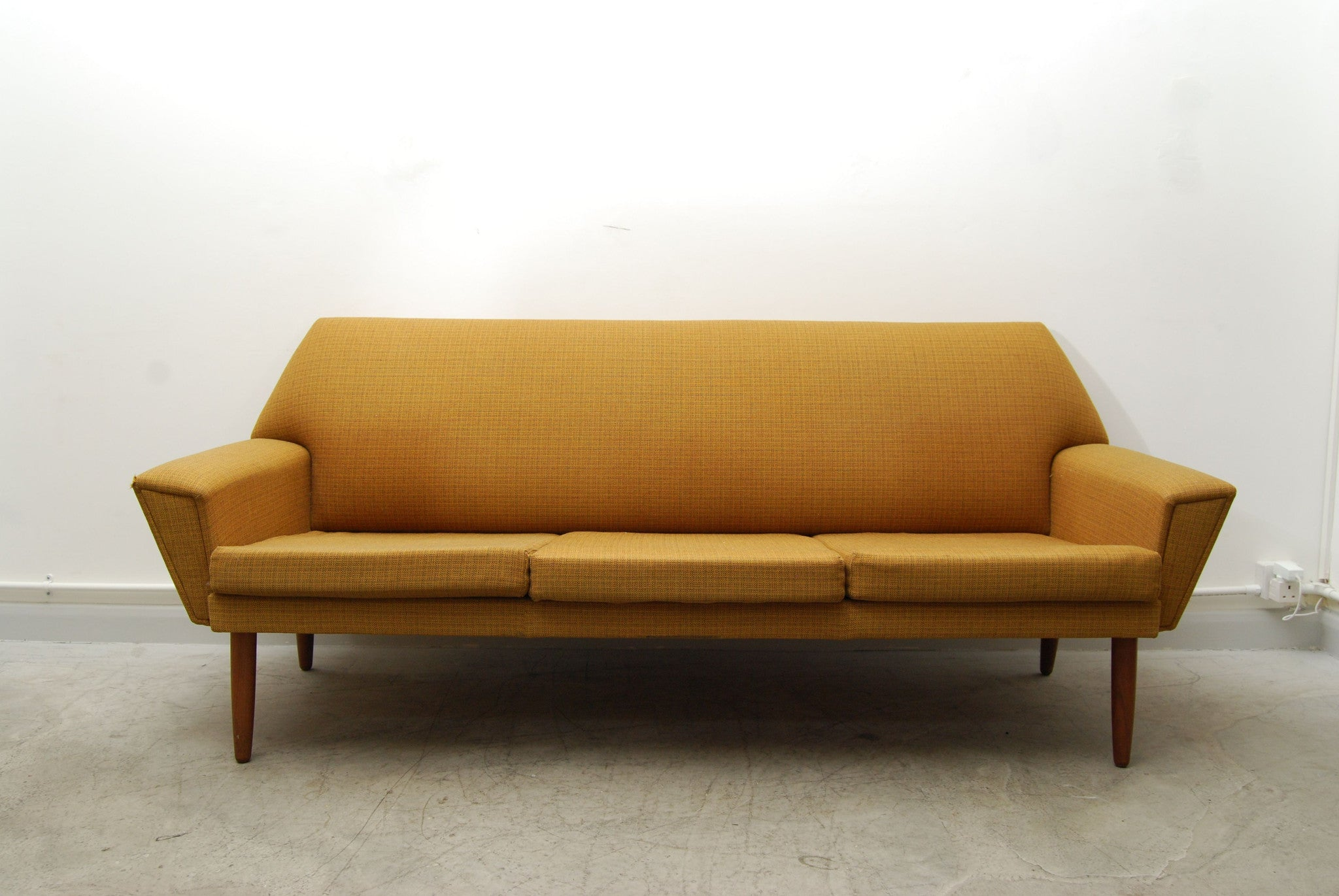 Three seat sofa in mustard yellow