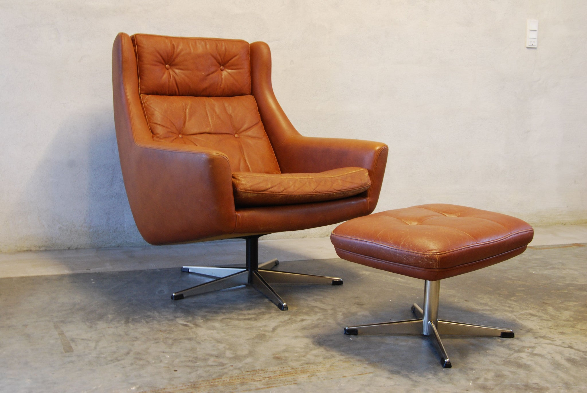 Swivel lounge chair with footstool