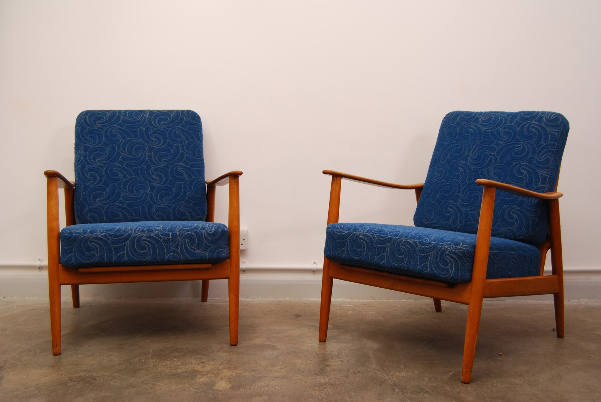 Pair of oak and teak lounge chairs