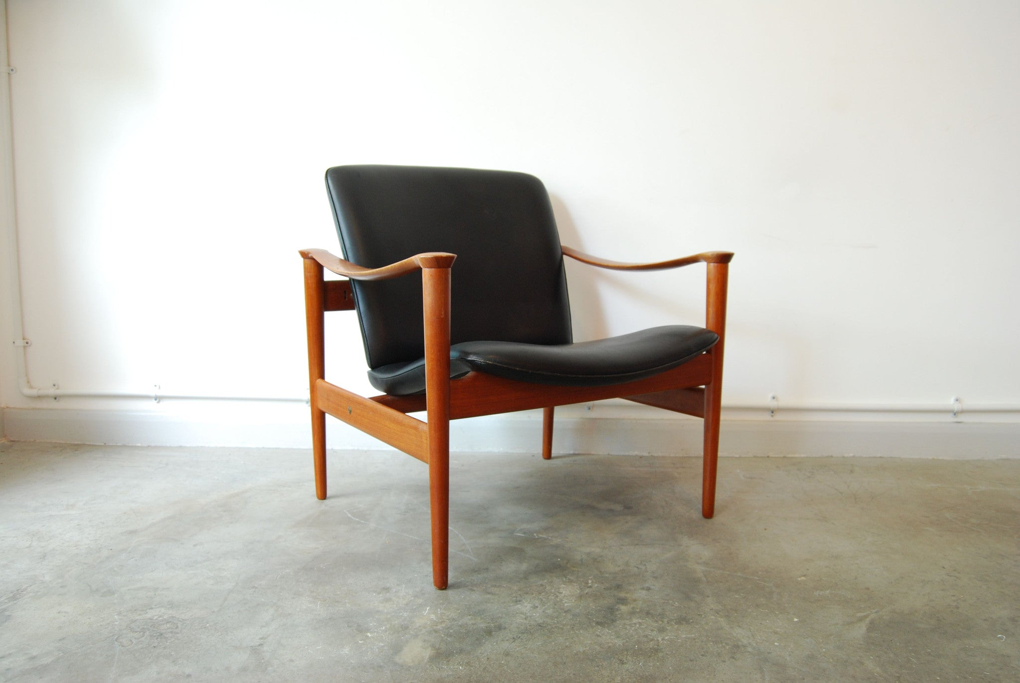 Chase & Sorensen Teak and leather lounge chair by Frederik Kayser