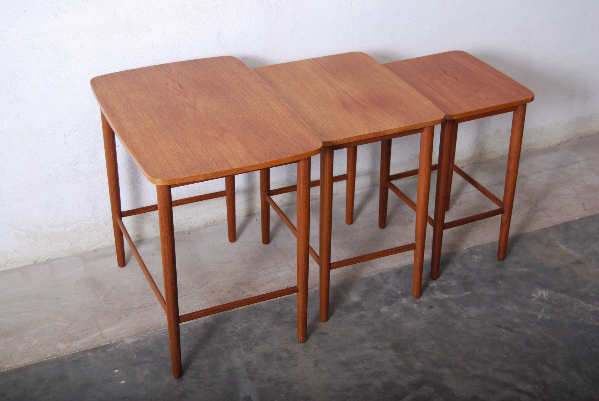 Nest of three tables in teak
