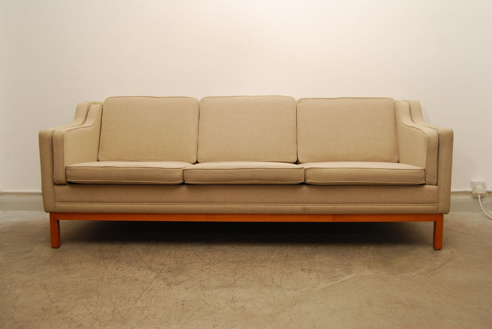 Light wool three seater in style of Mogensen