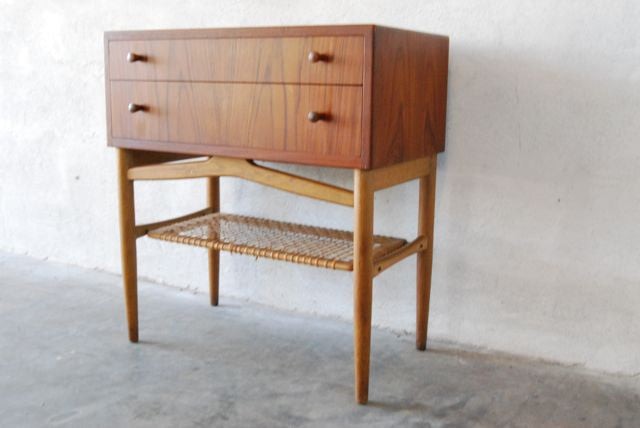 Short chest of drawers with cane shelf