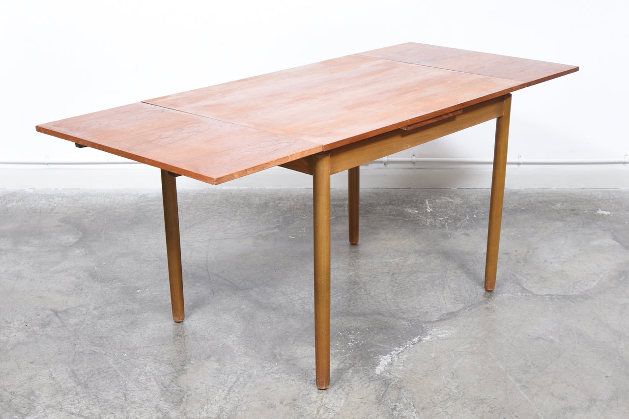 Extending teak dining table with beech base + legs