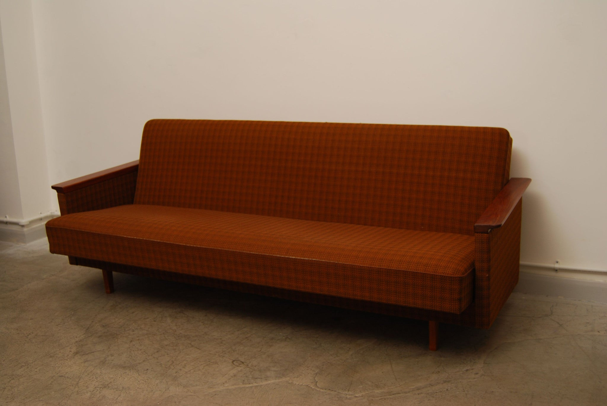 Sofabed with teak arms