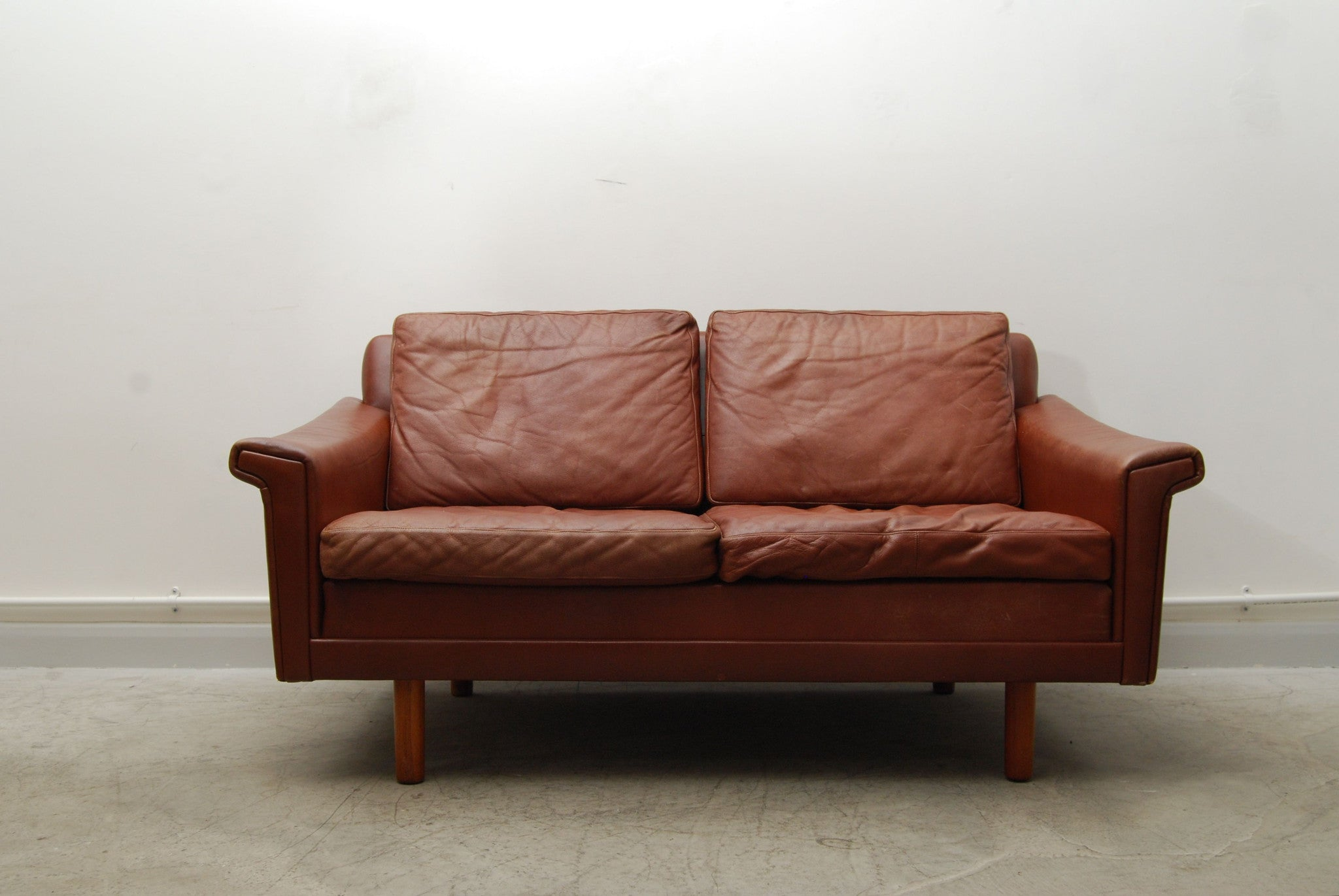 Two seat caramel leather sofa