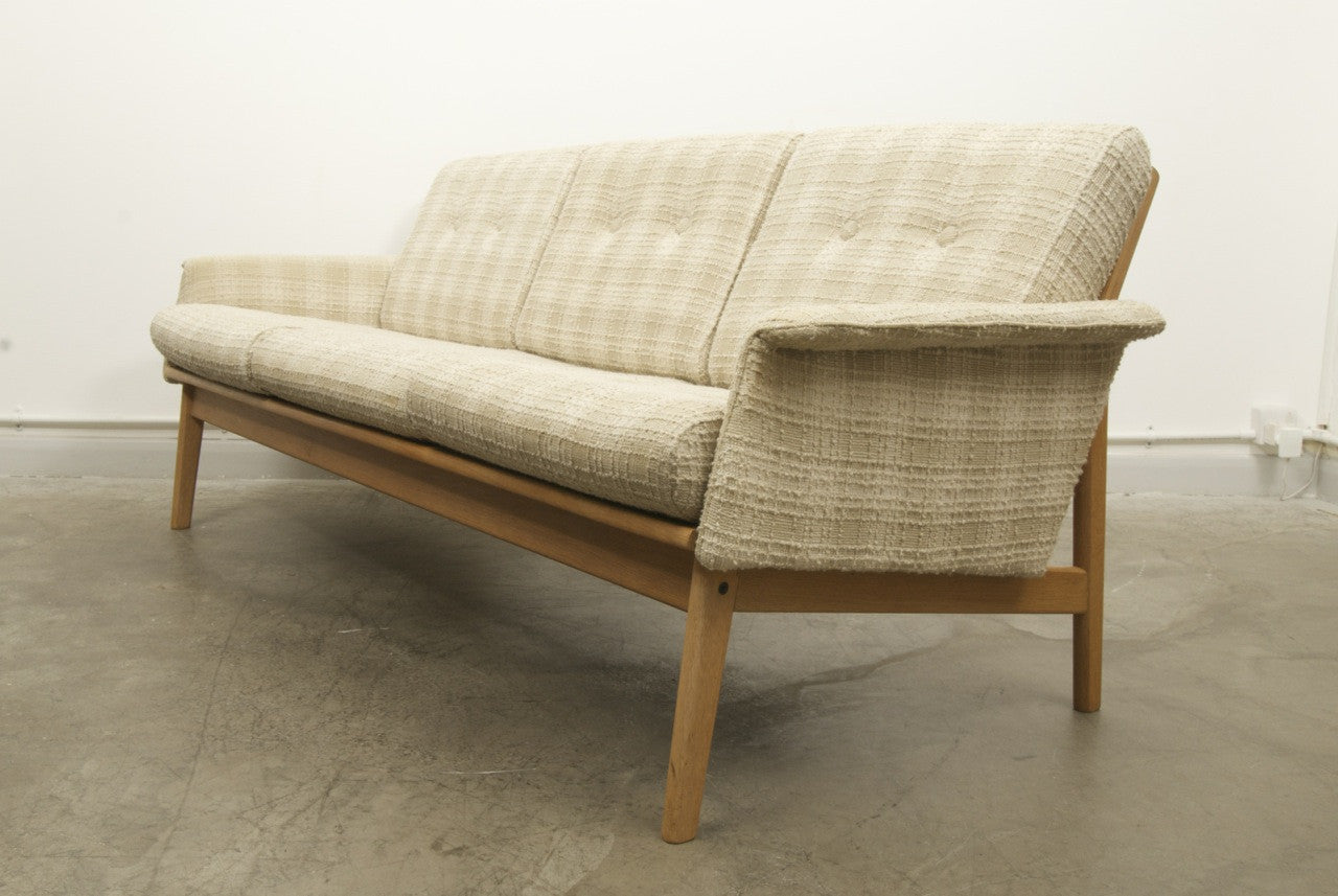 Light wool and oak three seater