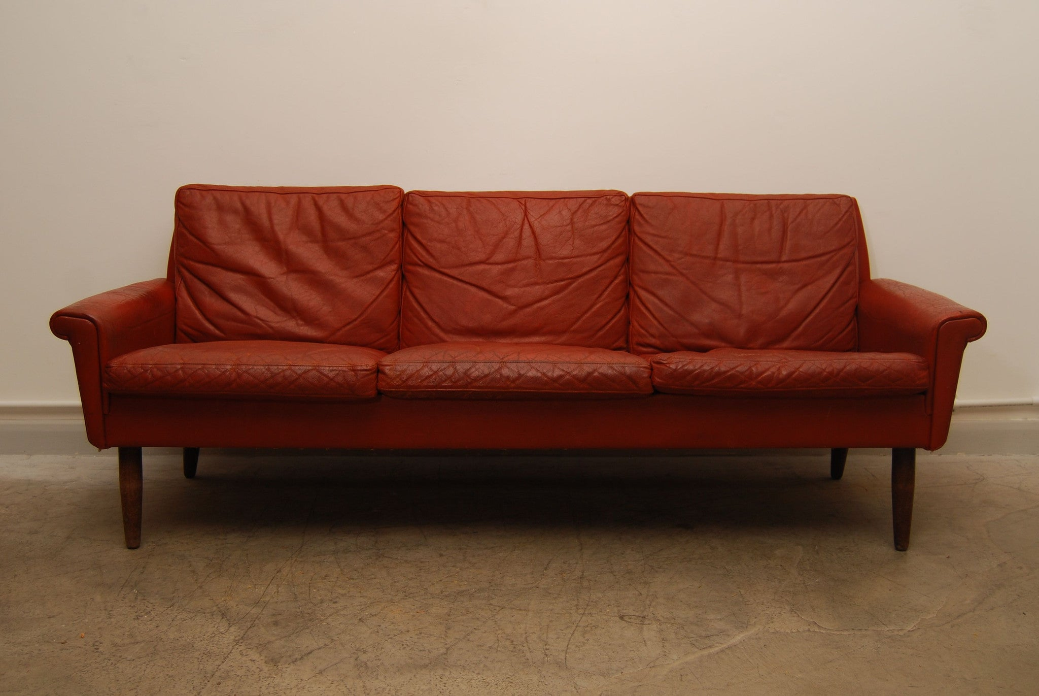 Red leather three seater