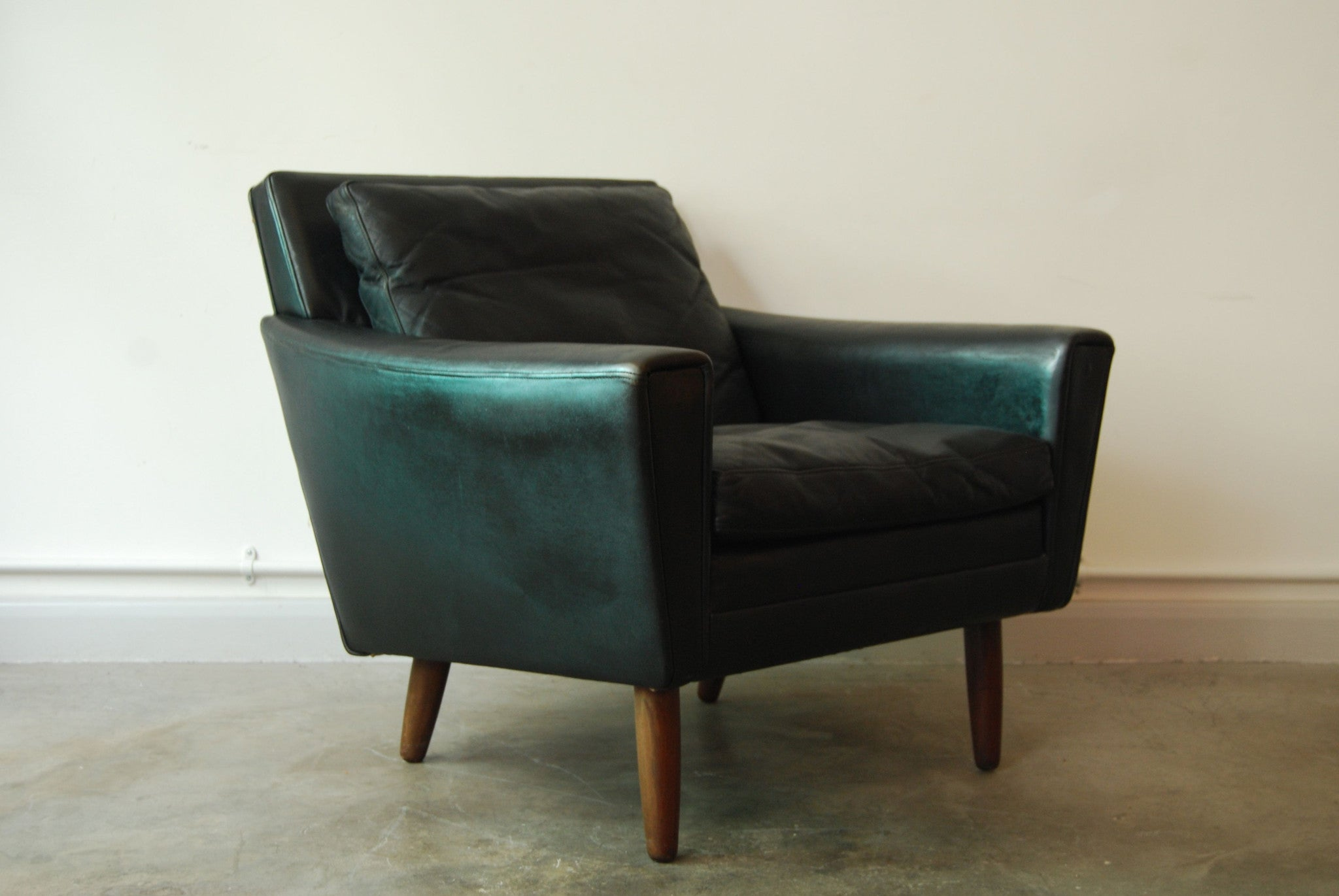 Black leather low back lounger