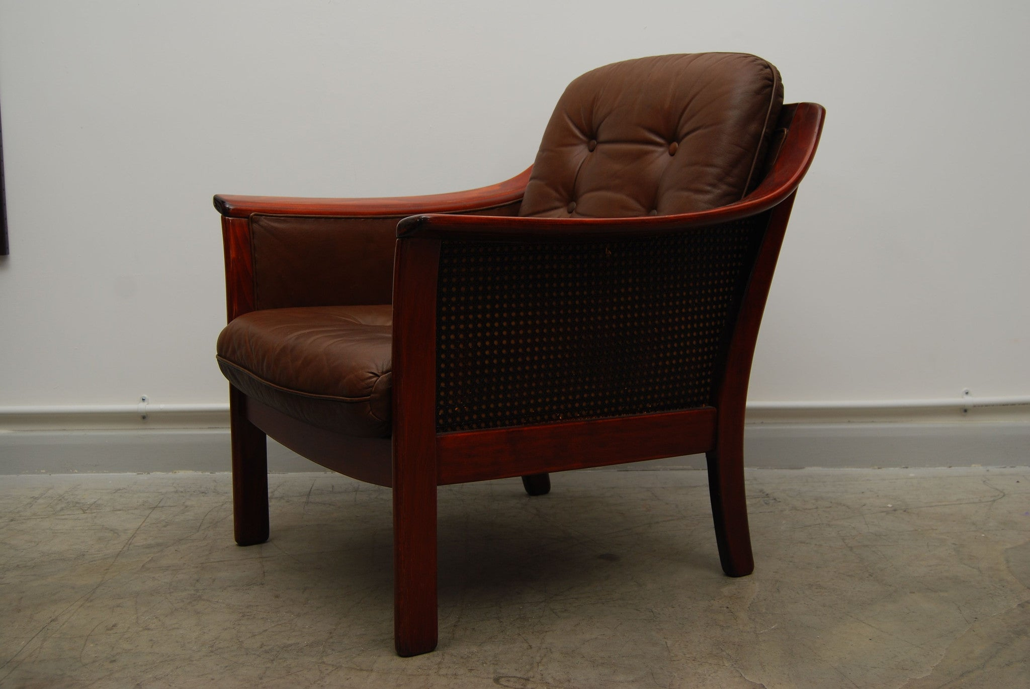 Pair of leather and beech lounge chairs