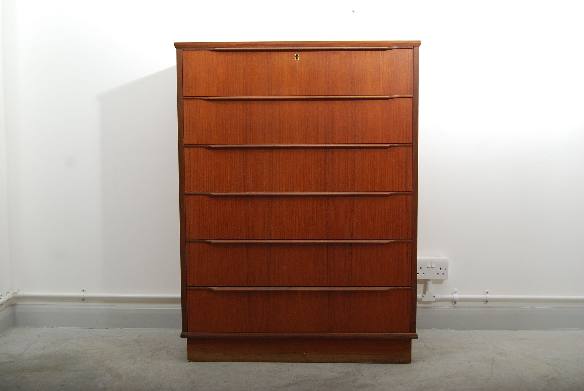 Tall teak chest of six drawers
