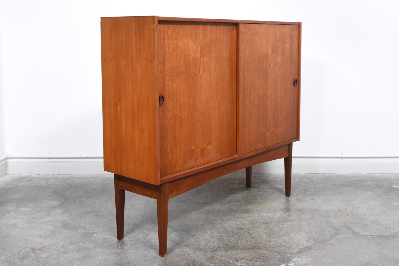 1960s teak storage cabinet with sliding doors