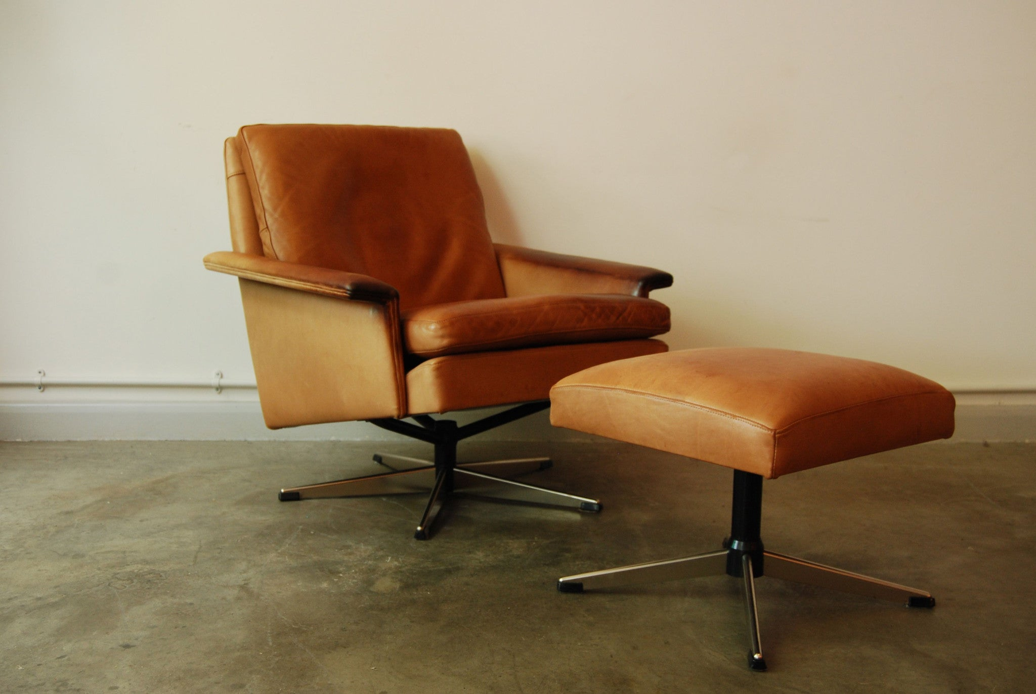 Leather lounge chair with matching footstool