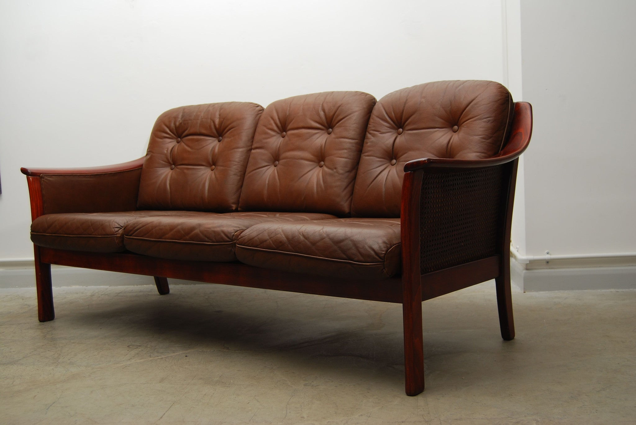 Three seat leather and beech sofa