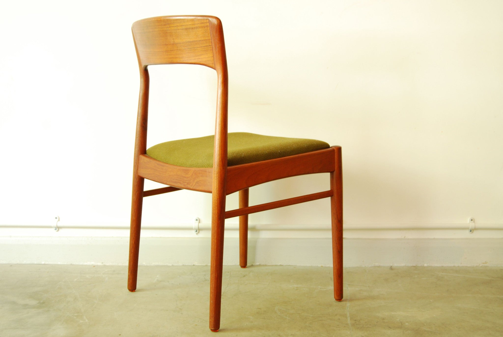 Set of five teak dining chairs by Johannes Andersen