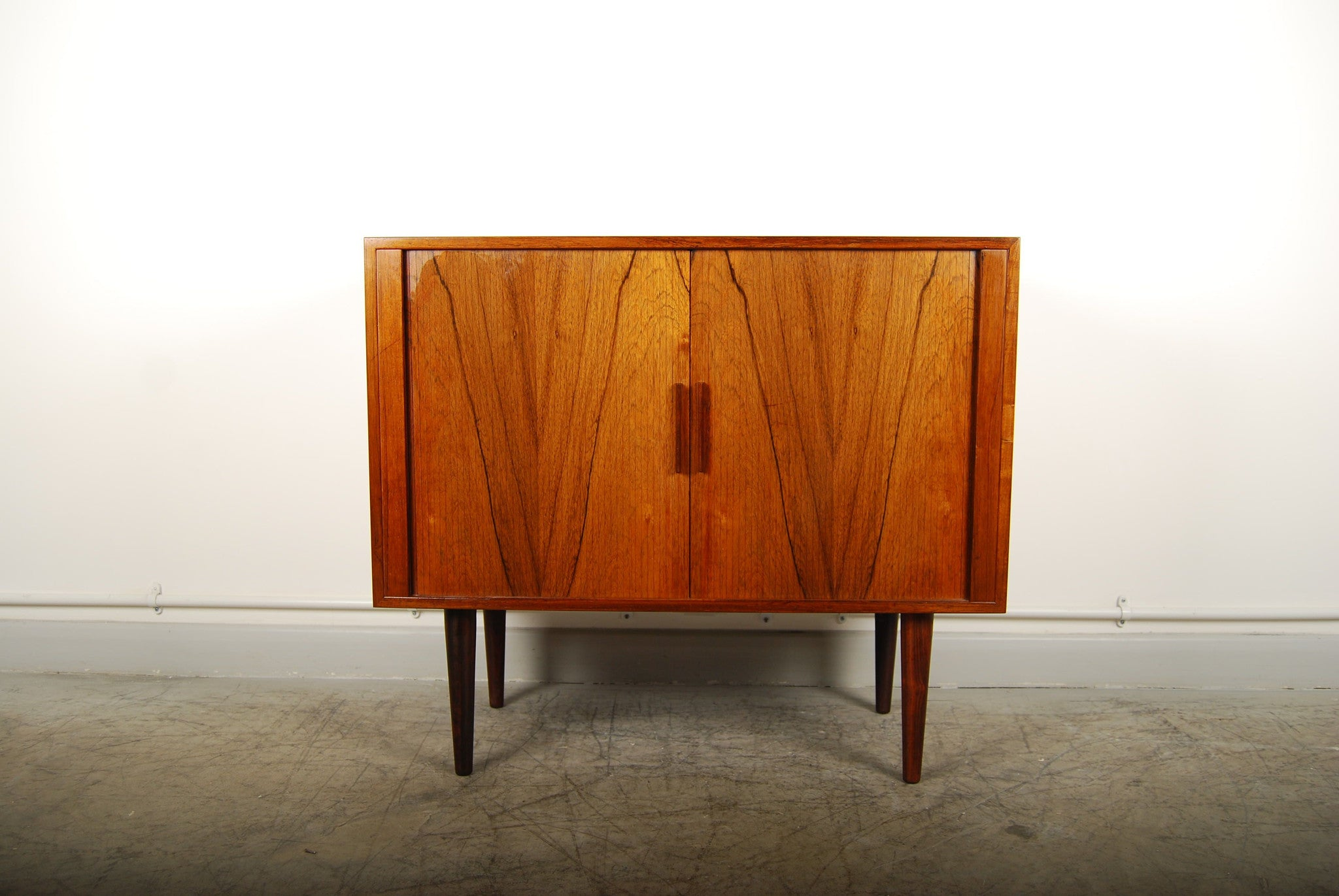 Rosewood short sideboard with tambour doors