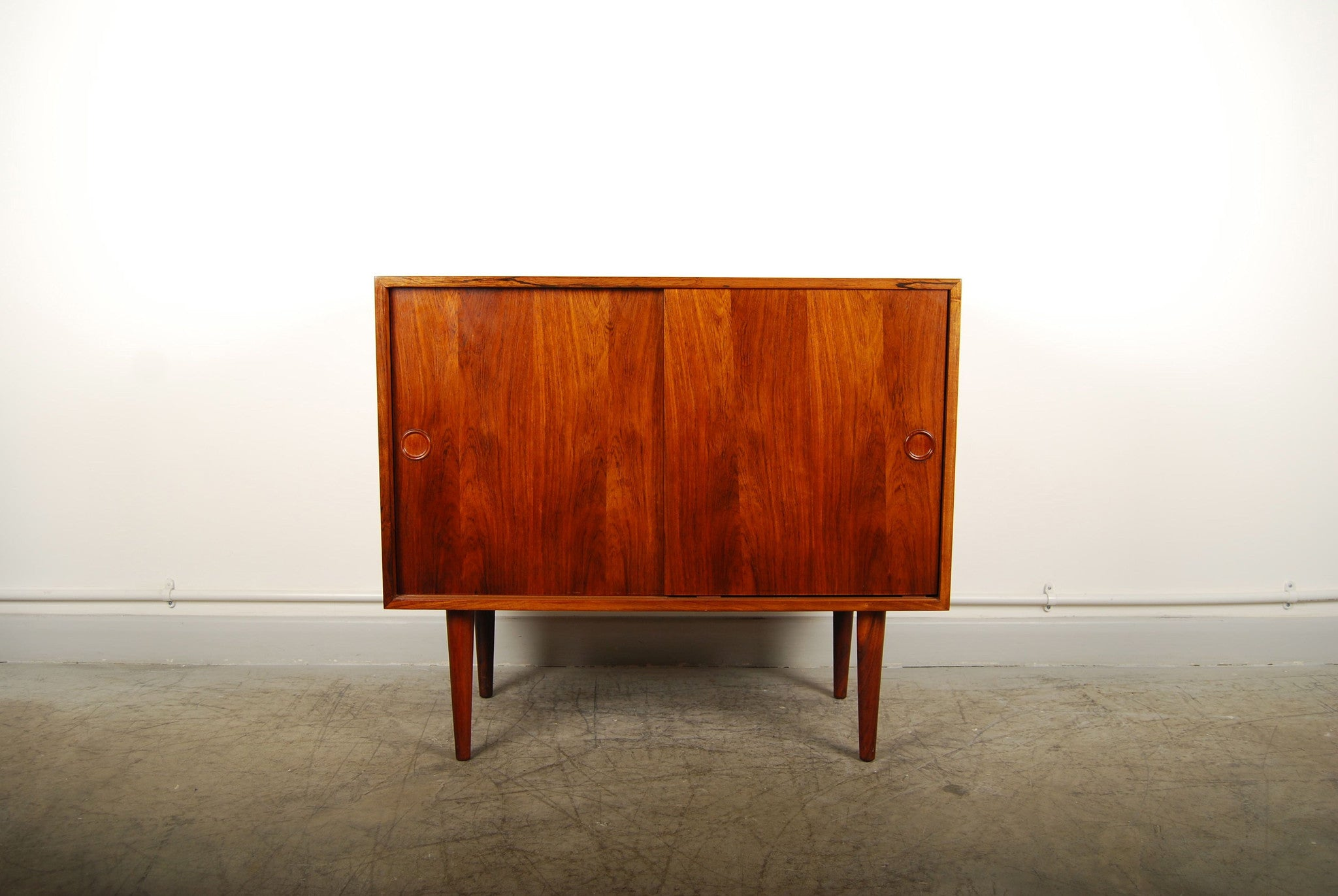 Short sideboard in rosewood with sliding doors