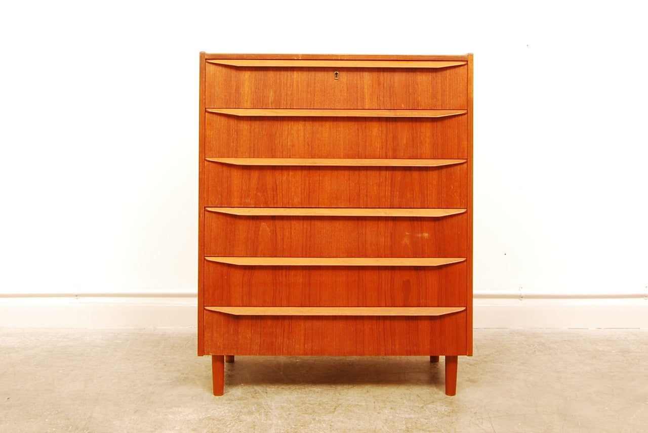 Teak chest of six drawers with lipped handles