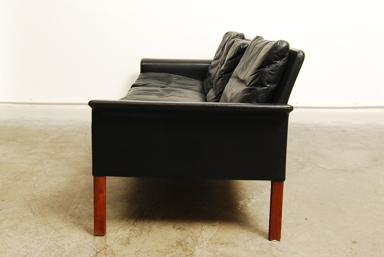Three seat leather sofa by Hans Olsen