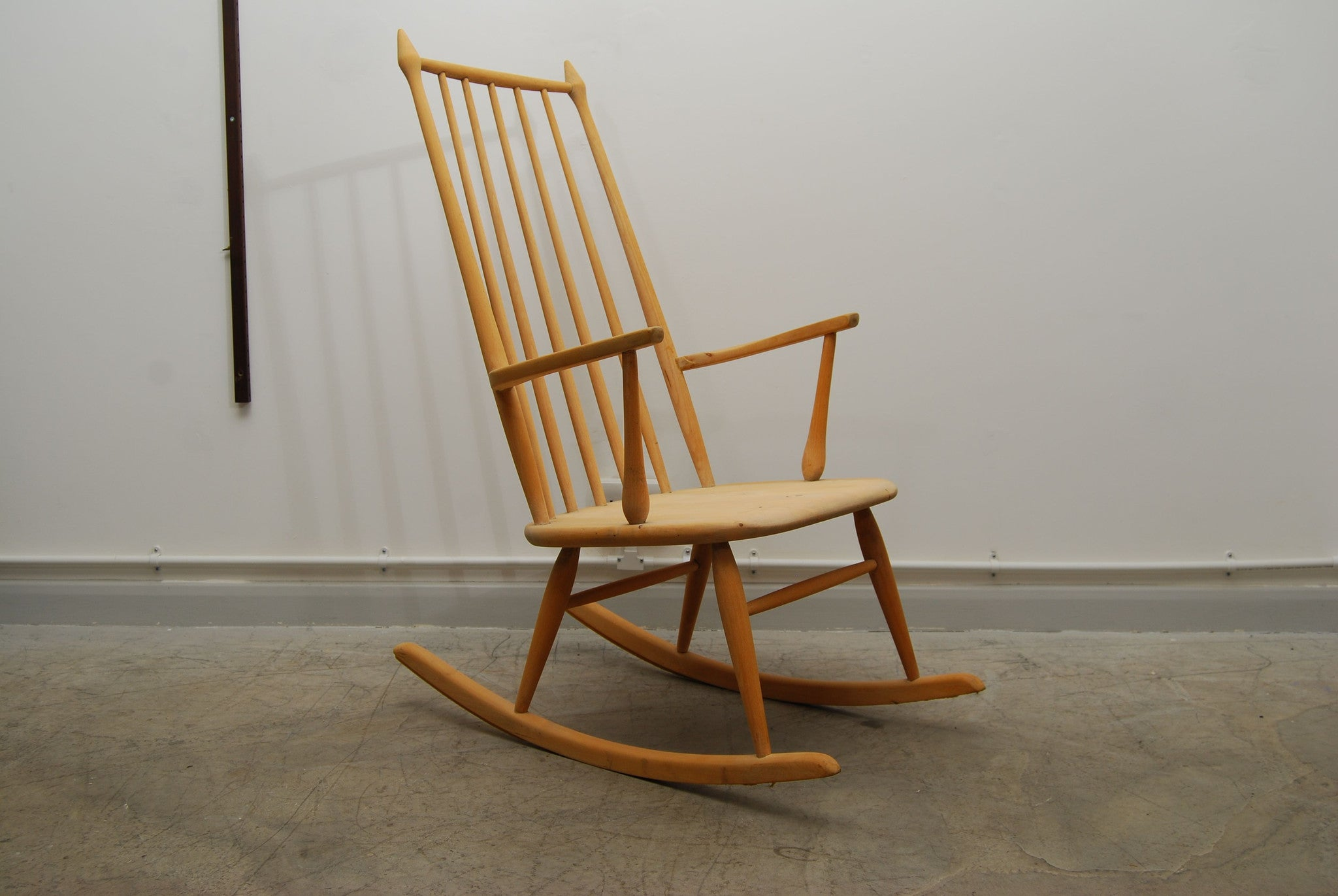 Highback rocking chair by Gemla Dio